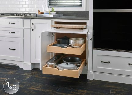 Roll-out trays serve many purposes, this one has the pots-and-pans storage covered!