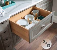 Deep storage drawers with peg-post dividers provide easy access to dishware.