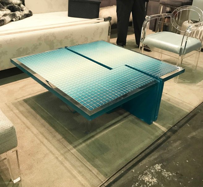 Coffee table in lucite (hot trend) with geometric imprints.